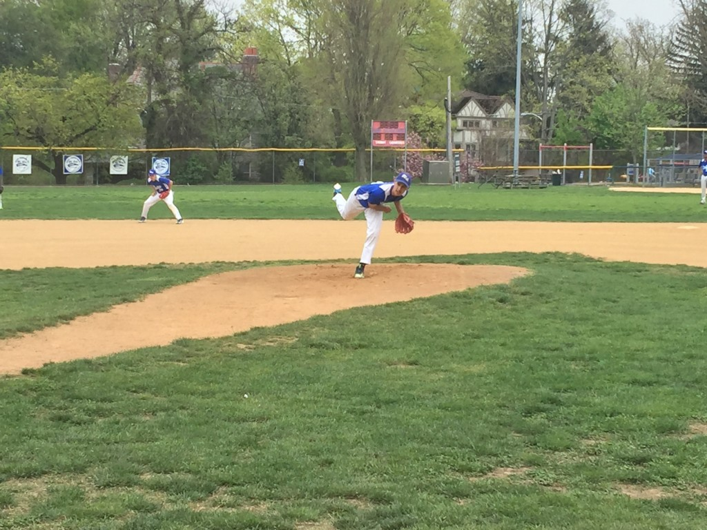 Lukas Aznar pitches in the 1st inning against E&M